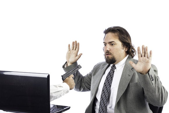 shutterstock ransomware man pointing gun out of computer