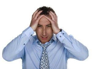 businessman with stress headache pain frustration