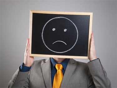 Man with sad face on chalkboard