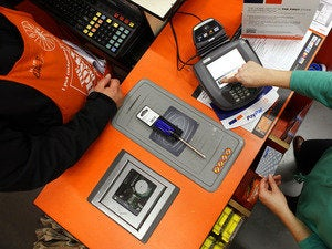 Checking out at the Home Depot cash register.