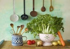 still life with kitchen utensils and fresh vegtable on butch block table