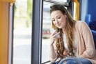 thinkstockphotos 466776077 woman on bus with iphone