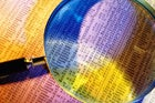 colorful financial report with magnifying glass