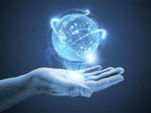 hands with floating virtual globe
