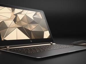 hp spectre 13.3 right facing paired with wireless mouse