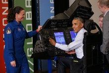 Obama touts tech R&D, fist bumps man with mind-controlled robotic arm