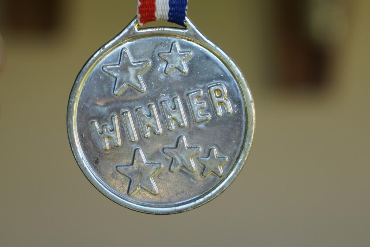 winner medal contest victory